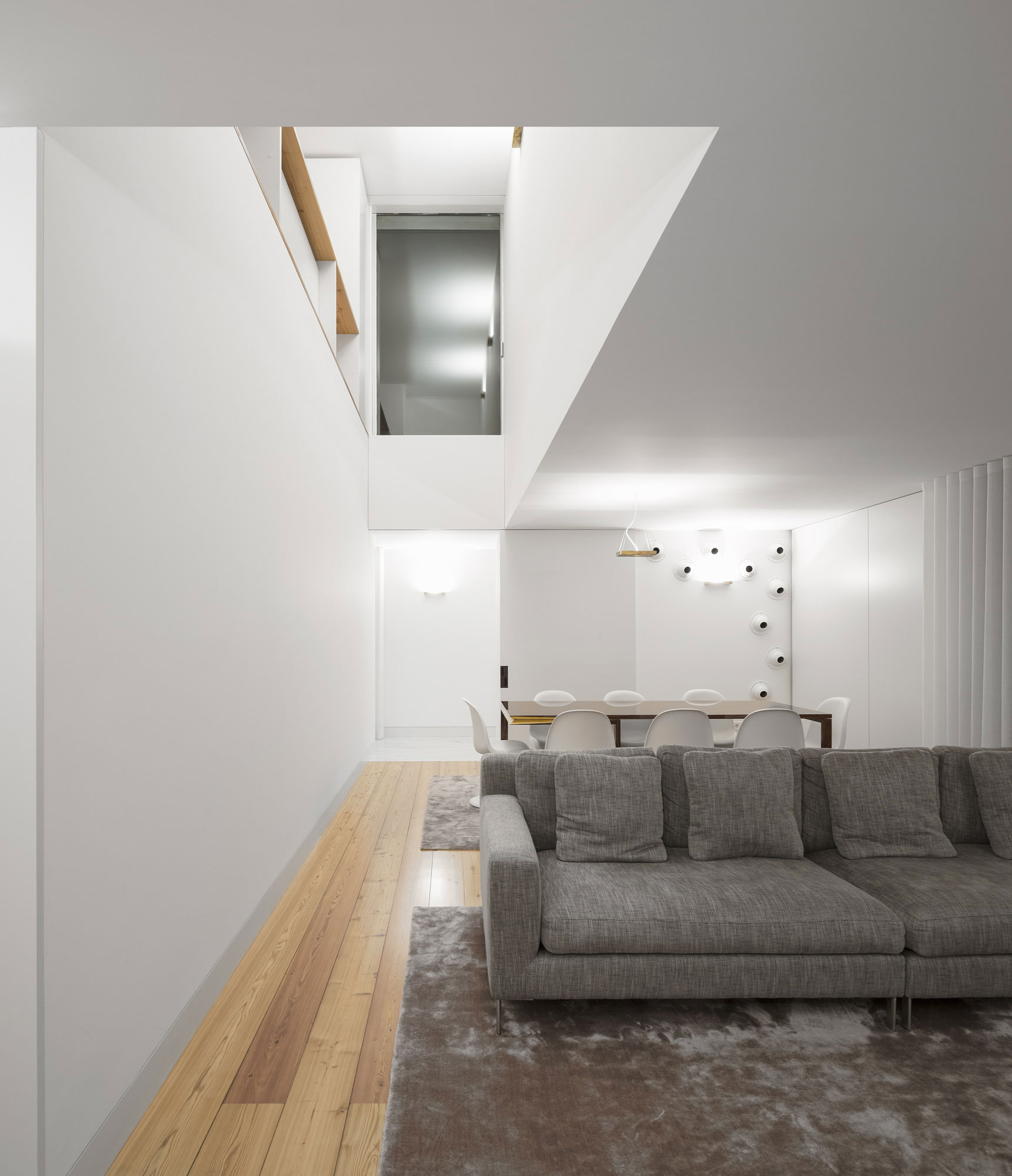 living-and-dining-room-large-modern-house-design-with-white-interior-color-decorating-ideas-plus-sofa-bed-wooden-table-and-chairs